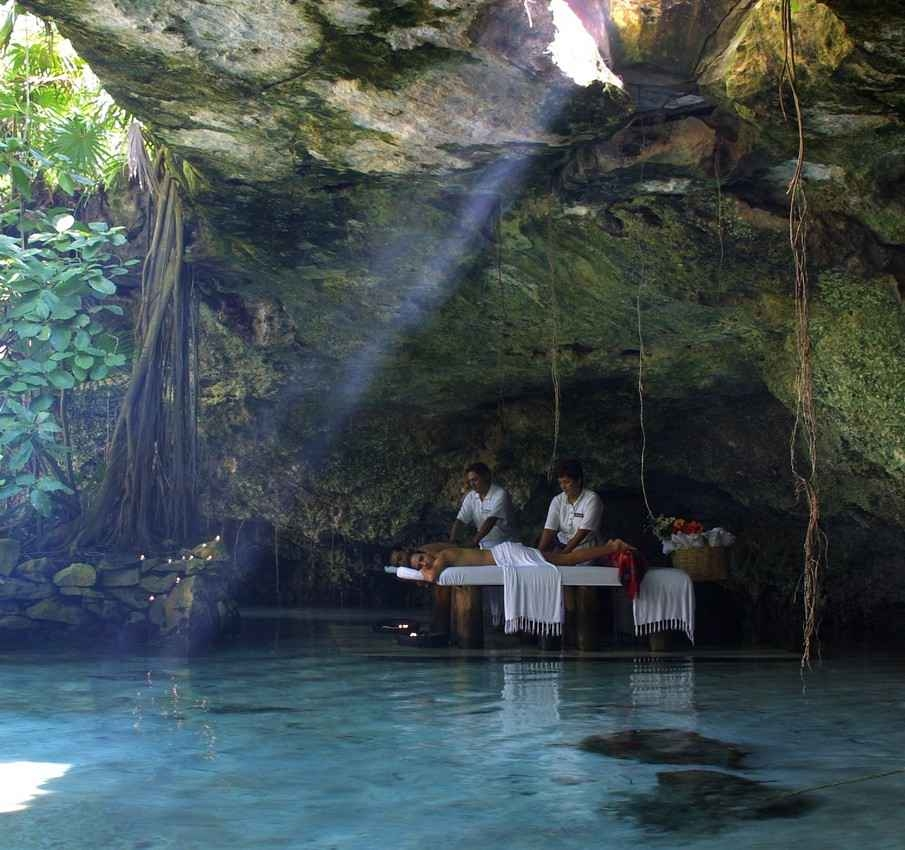 A woman receiving an exotic massage at the entrance of a local cenote.