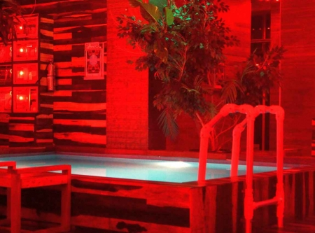 A popular bar with a small swimming pool inside.