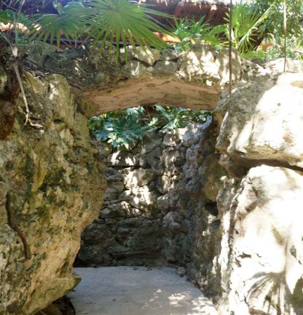 An amazing stone walkway under a palapa.