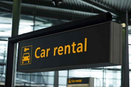 A car rental sign.