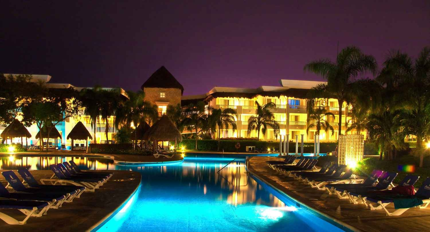 A large resort at night with many lights.