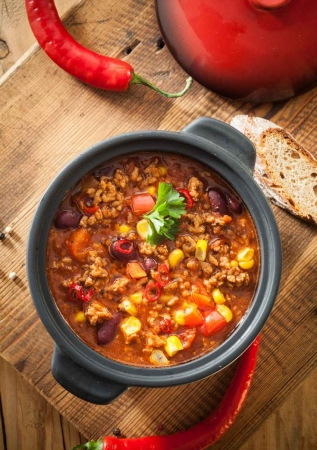A slow cooker full of delicious chili.