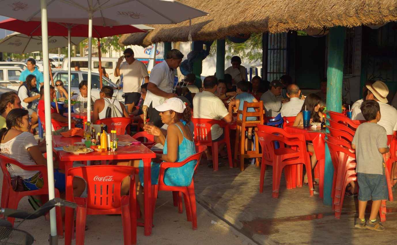A small seafood restaurant near Playa Del Carmen at sunset.