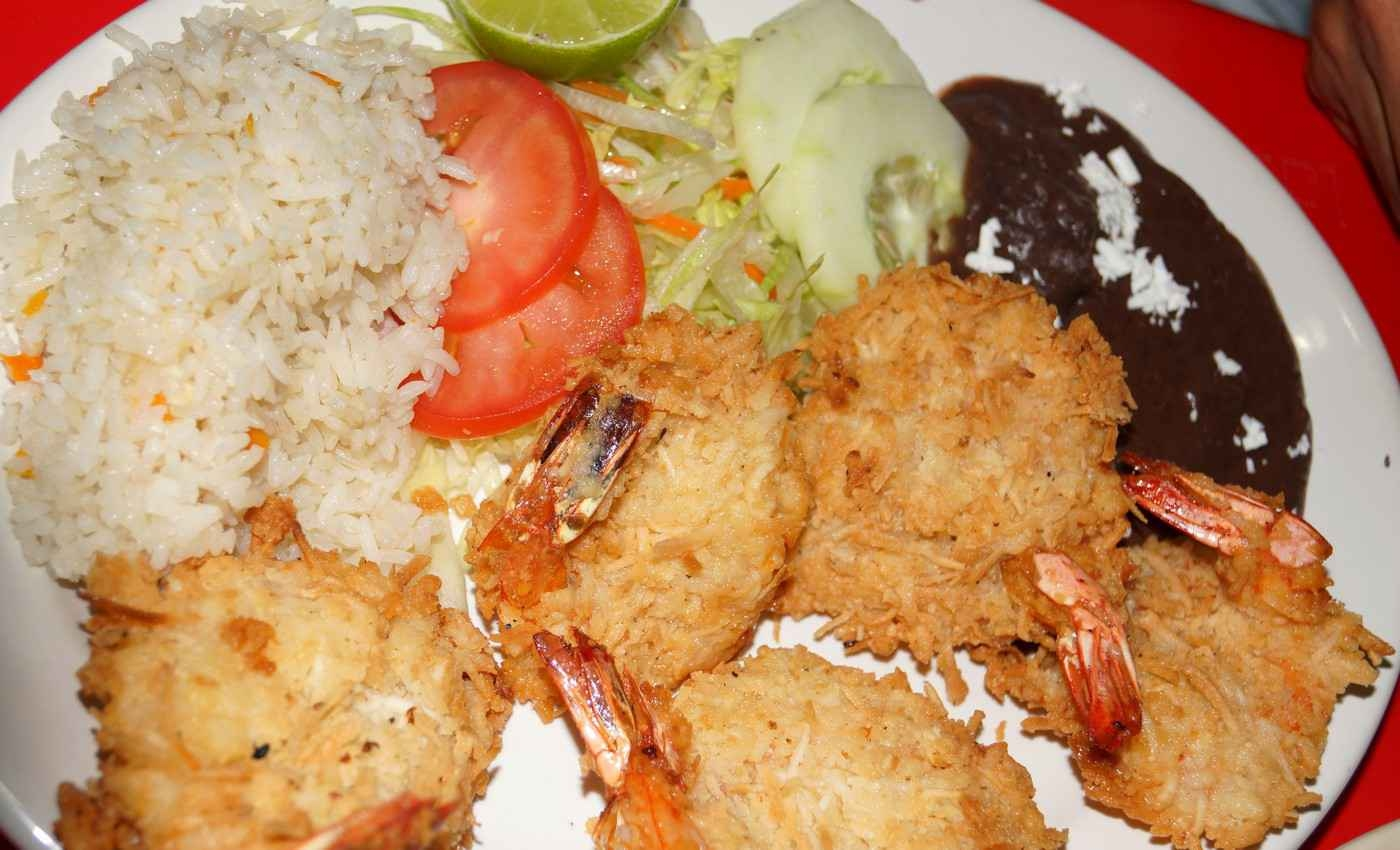 A plate of deep-fried shrimp with rice and vegetables as served at a restaurant in Playa Del Carmen.