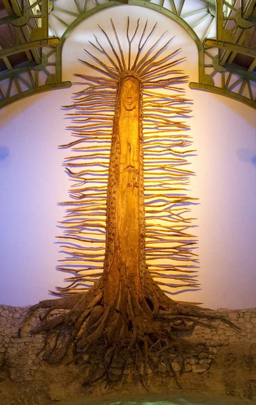 A Mayan Christian tree with deep roots in a church.