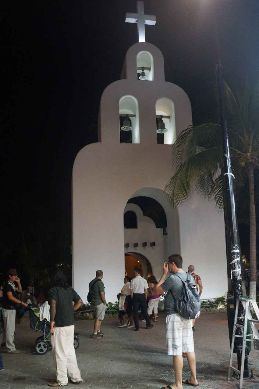 A group of people sightseeing near a popular church in downtown Playa Del Carmen.