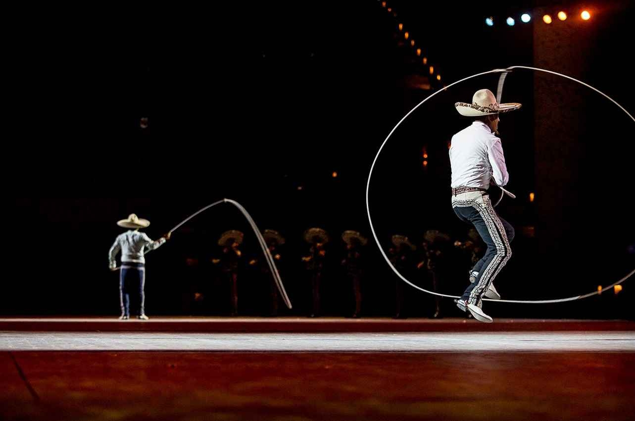 Mexican cowboys playing kids game of Jump Rope.