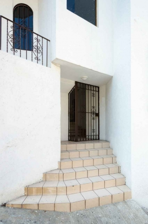 A short stairway and entrance to a residential building.