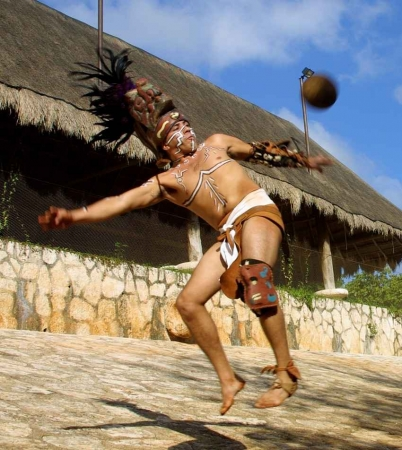 A reenactment of a Mayan warrior playing a famous ballgame during a ceremonial competition.