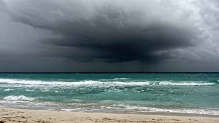 Dark skies and a rough ocean near Playa Del Carmen.