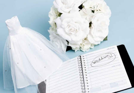 The word wedding written in the notebook of a planner.