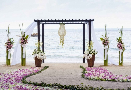 A canopy style wedding ceremony on the beach.