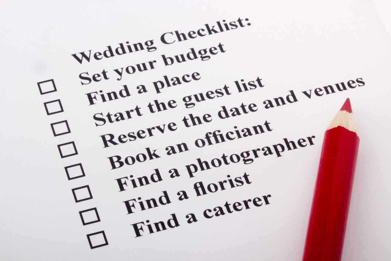 A wedding to-do checklist with a red pencil.