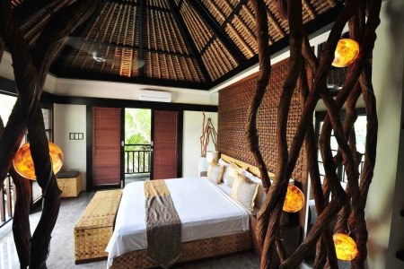 A nature friendly resort room overlooking the city and jungle in Playa Del Carmen.