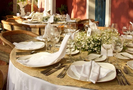 Several sets of beautiful wedding cutlery at a Playa Del Carmen wedding venue.