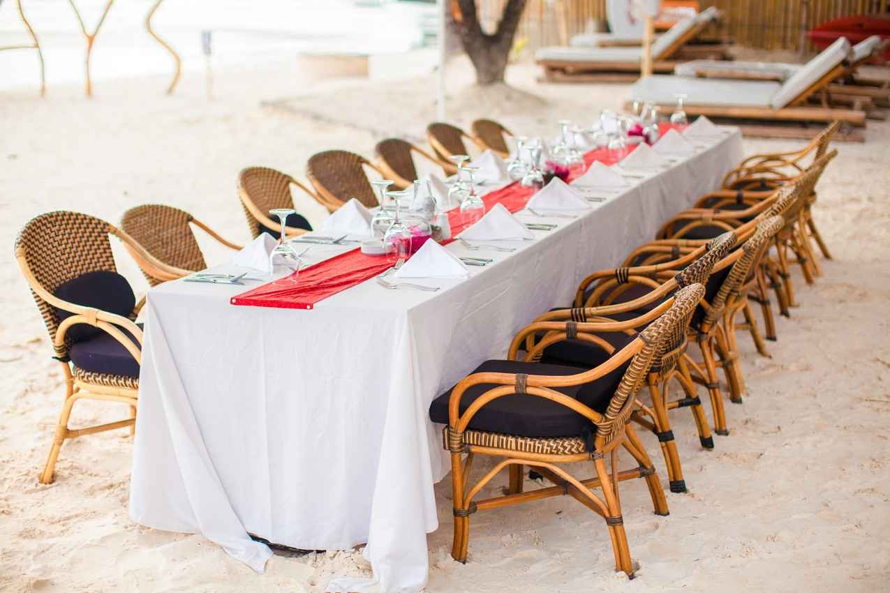 A long wedding tables set up on the beach in Playa Del Carmen.