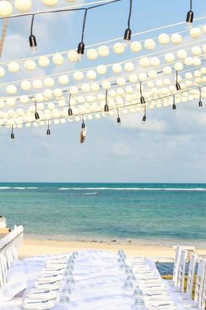 A Playa Del Carmen beach decorated for a daytime wedding.
