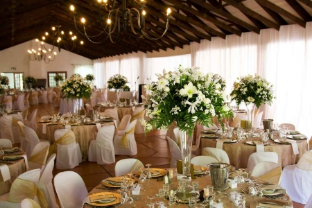A wedding facility with fancy tables and decorations.