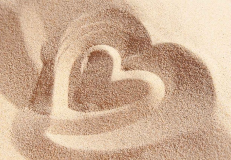A large heart drawn in the sand.