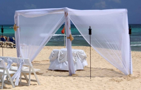 The preliminary preparations for a beach wedding ceremony.