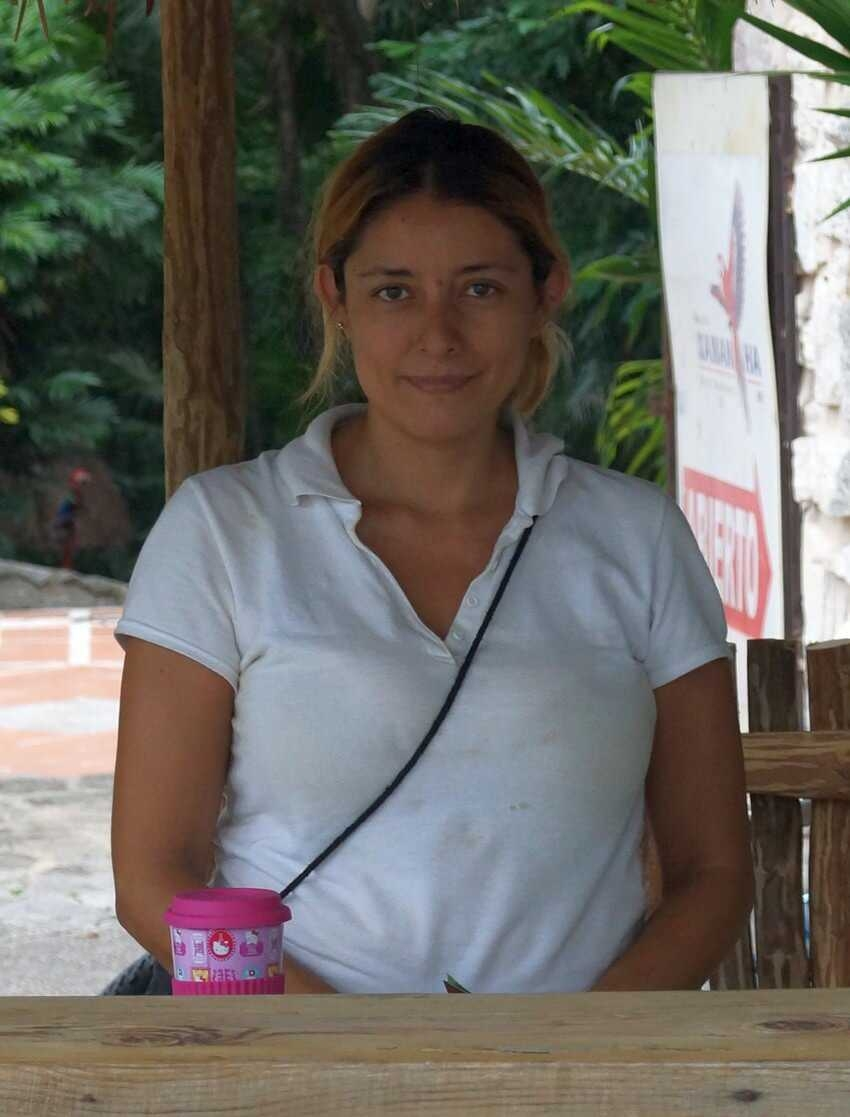 Elizabeth Sanchez selling tickets at Xaman-Ha bird sanctuary.