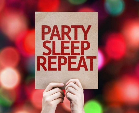 A sign that reads PARTY, SLEEP, REPEAT.