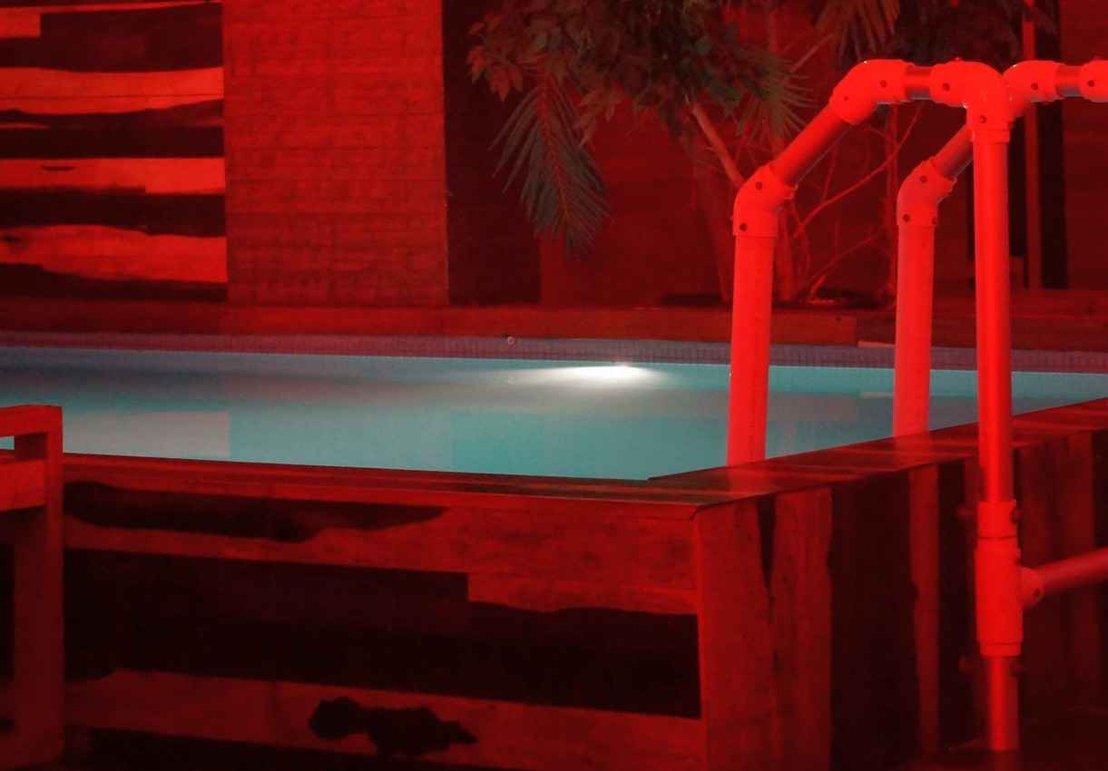 A small swimming pool in the red room at a Playa Del Carmen club.