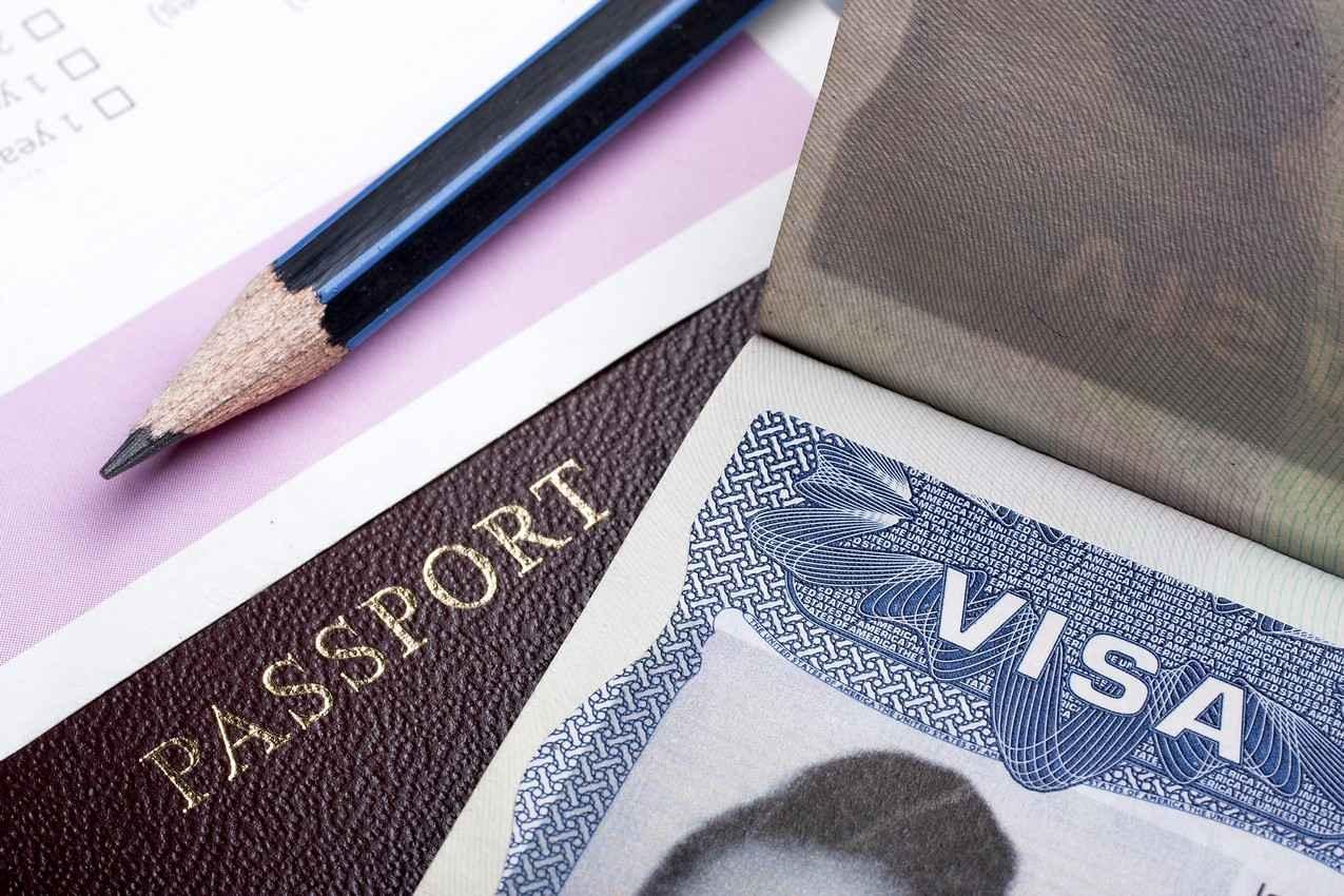 An international visa on top of a passport.