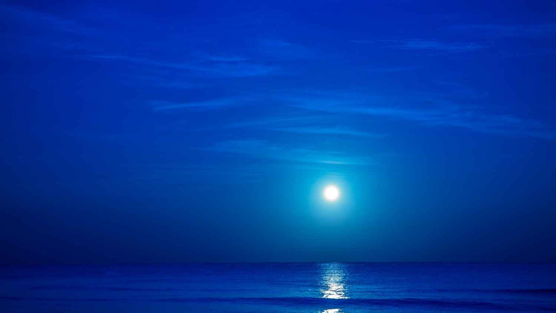 The beautiful moonlight reflecting off of the ocean near the Playa Del Carmen beach.