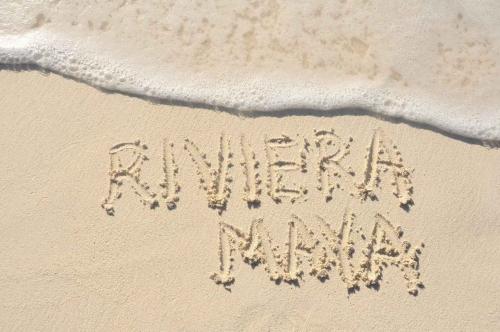 Riviera Maya written in the sand on the beach.