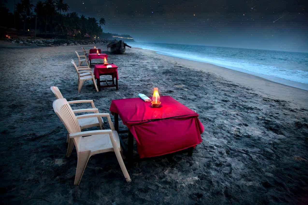 Several candlelit tables that were set up to view the night sky facing the beach.