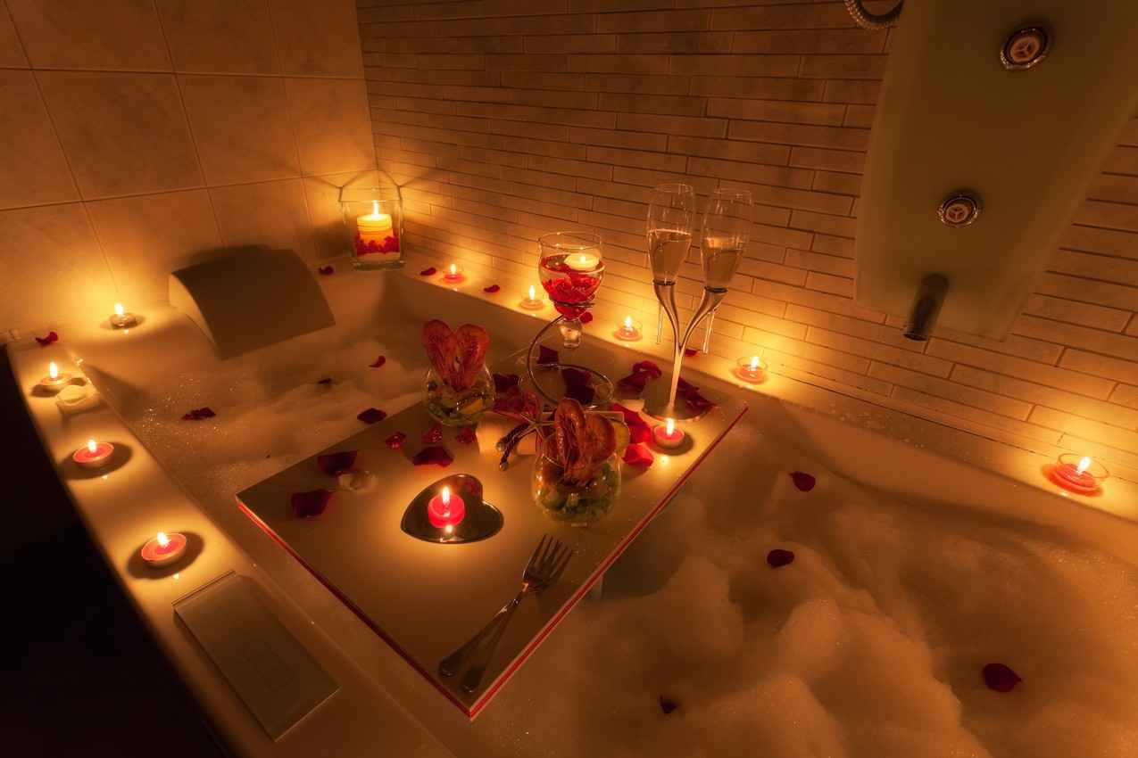 A candlelit romantic Jacuzzi with champagne served at a Playa Del Carmen wedding resort.