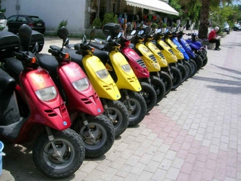A row of colored scooters for rent near Playa Del Carmen.