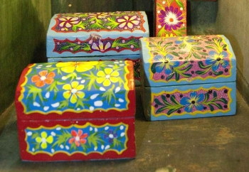 Several hand-painted wooden boxes for sale on Fifth Avenue.