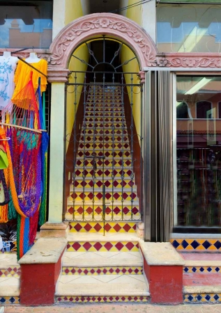 A colorful stairway leading to a hotel entrance.
