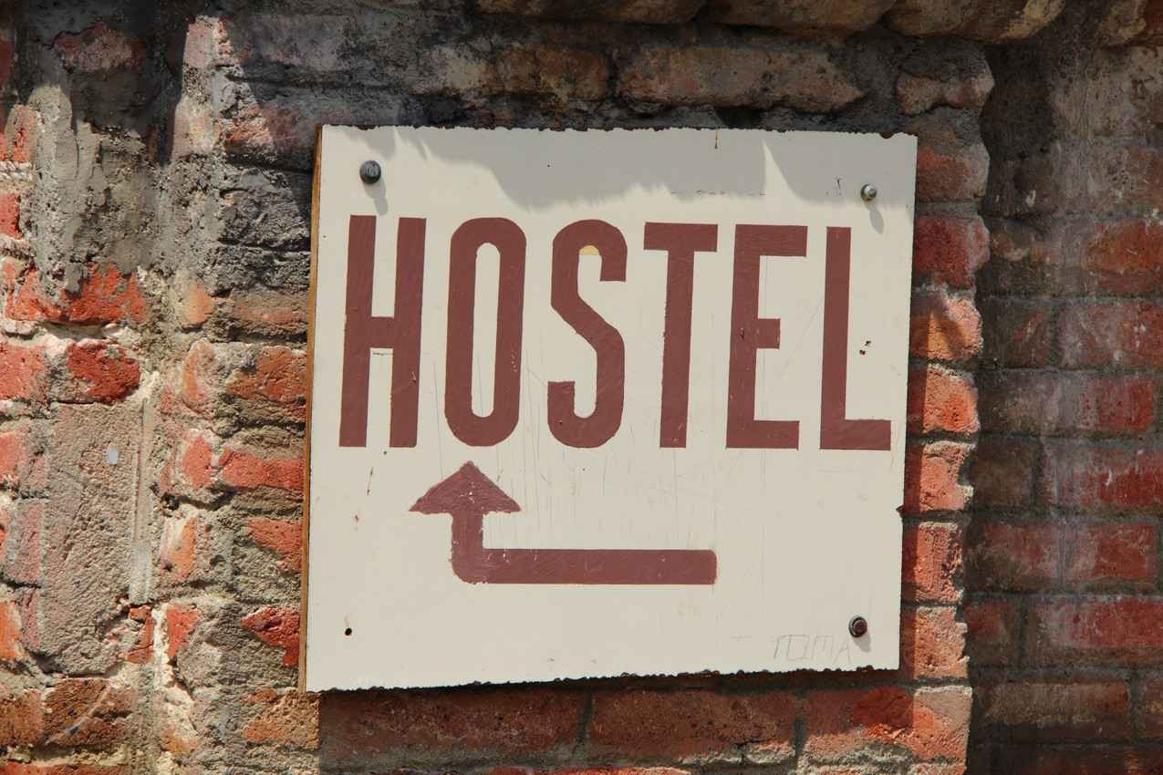 A hostel sign on a brick wall in Playa Del Carmen.