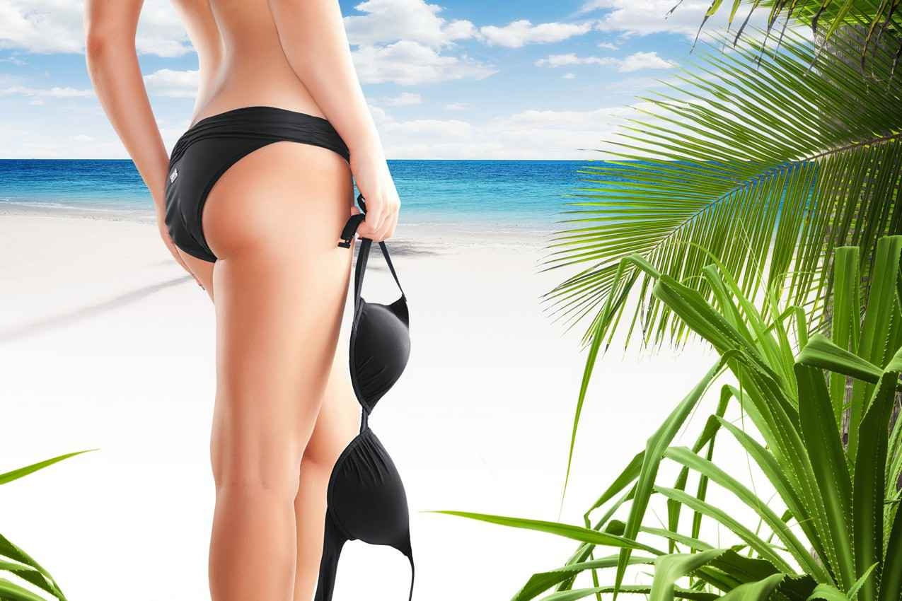 A hi-res cartoon showing a woman holding her bikini top at the beach.