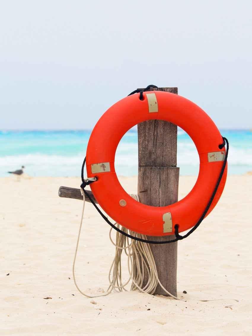 A lifesaver on the beach near the sea.