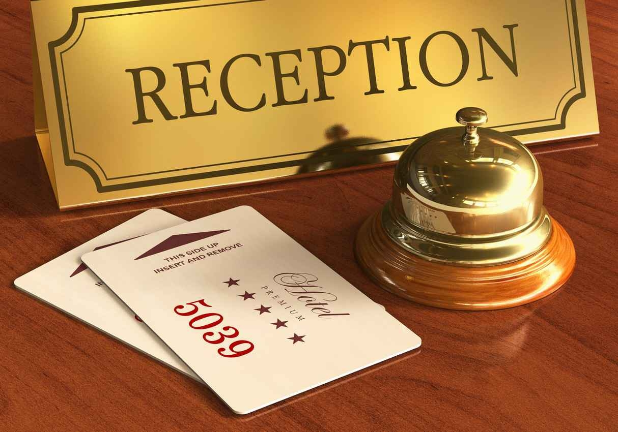 A reception desk with a service bell and a key card.