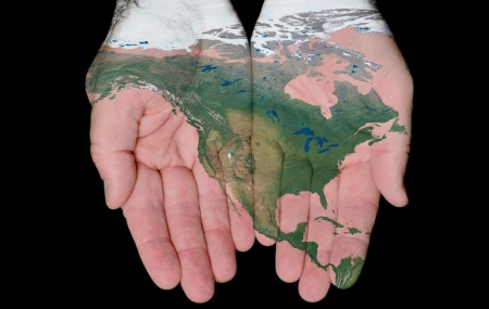 A representation of North America painted onto hands.