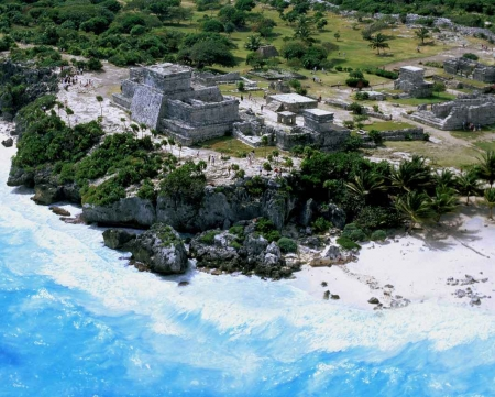 An aerial view of the front of the Tulum ruins and beach.