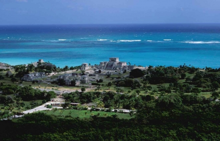 An aerial view of the Tulum ruins with the Caribbean Sea in the background.