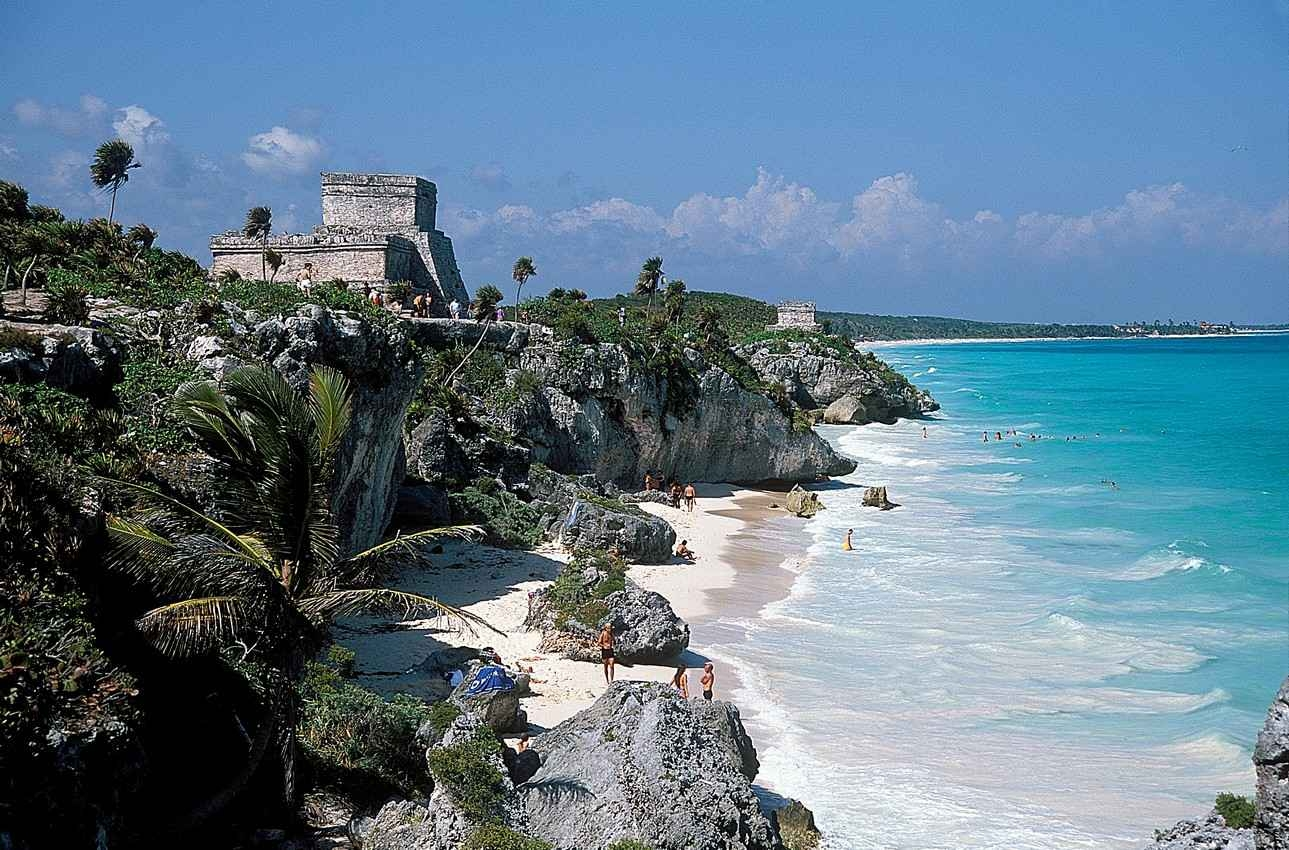 Crystal clear blue waters next to the Tulum ruins and beach.