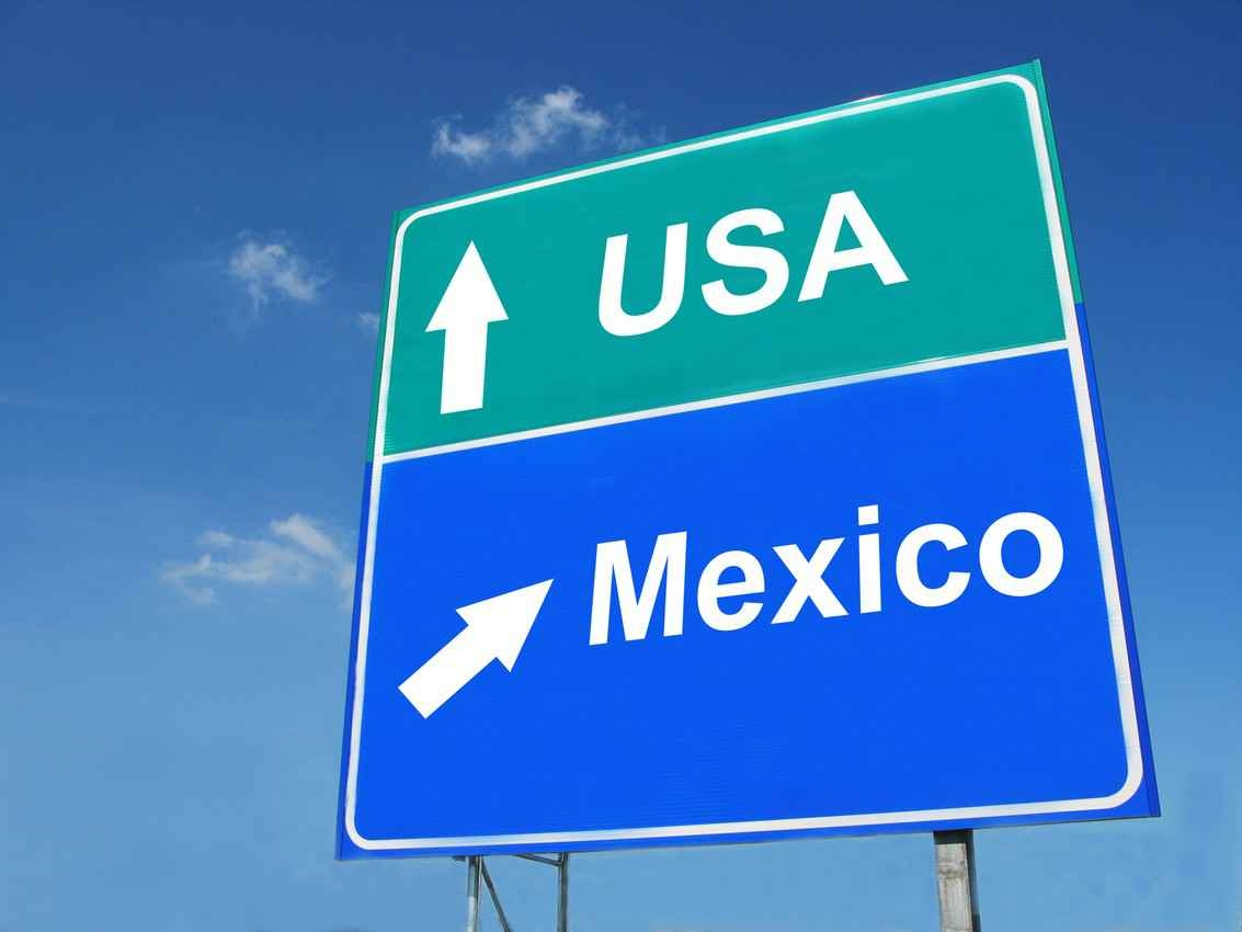 USA-Mexico direction sign.