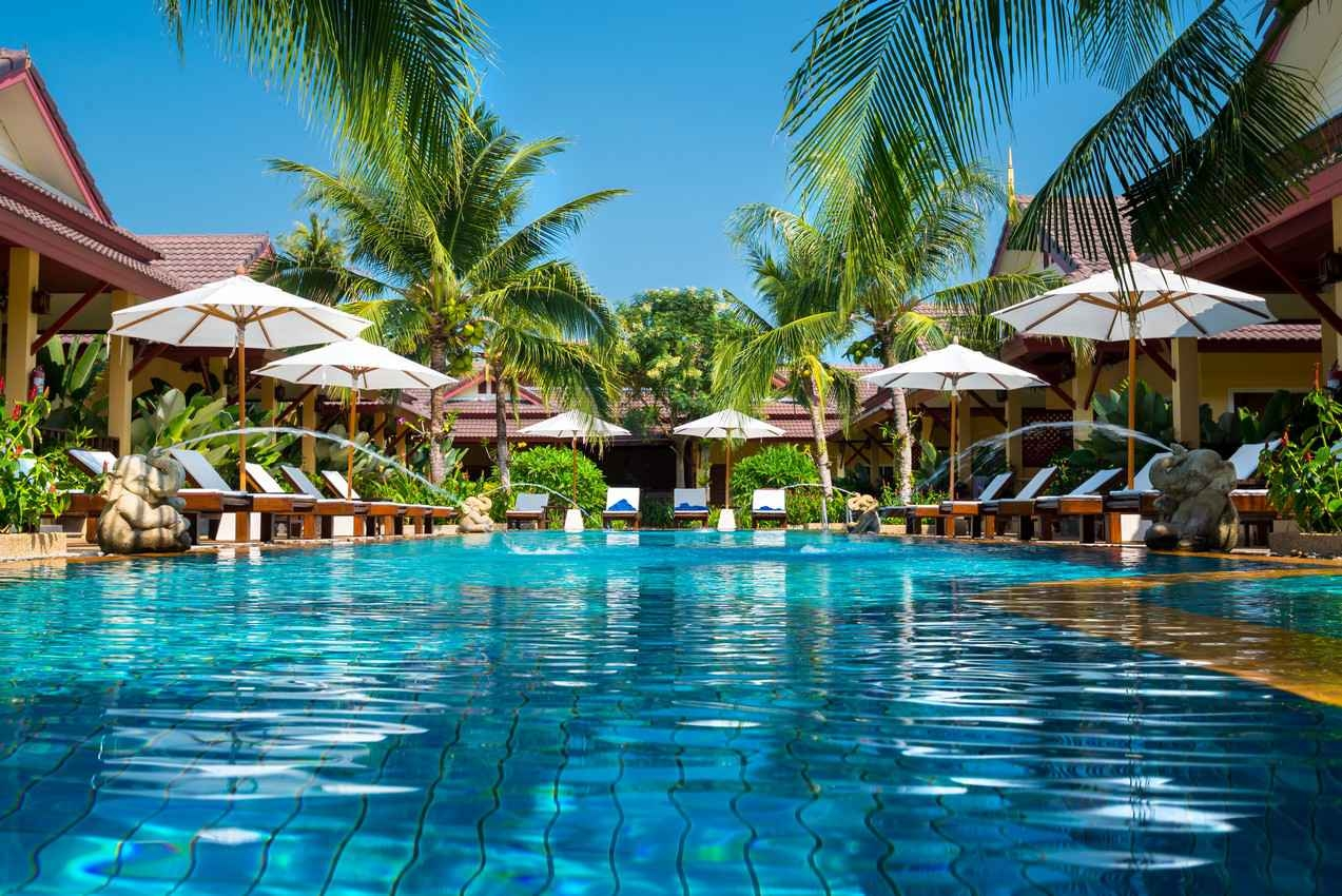 An amazing lagoon style swimming pool at a nature style resort.