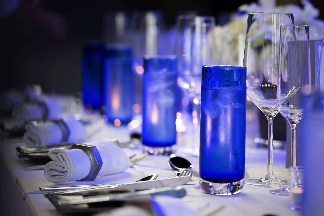 A dinner table set to serve a wedding party.