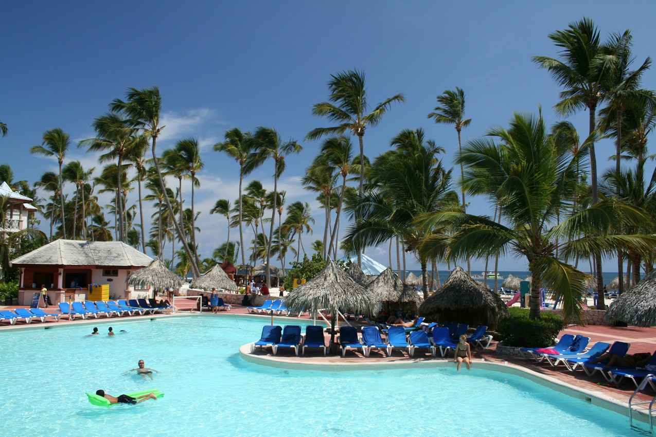 A large swimming pool near the beach at a five-star resort.