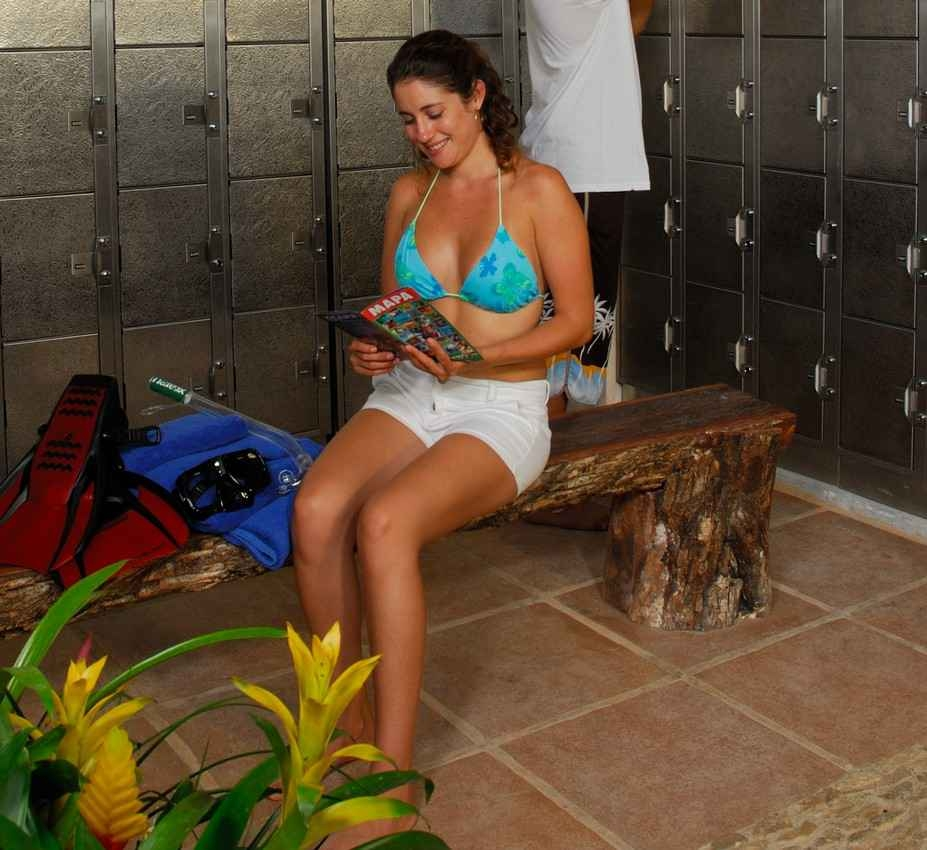 A woman within the secure locker area using a map to find the best snorkeling locations.