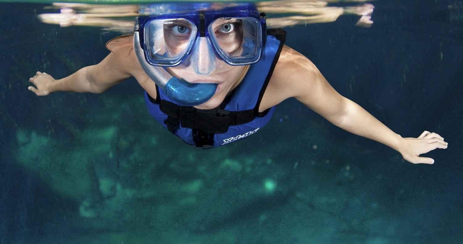 A woman snorkeling at the park.