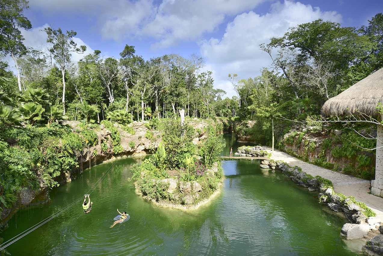 The cenote tourist attraction as seen on a beautiful day.